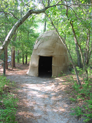 a replica of a traditional native american shelter